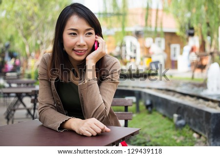 Woman talking on mobile phone at outdoor - stock photo