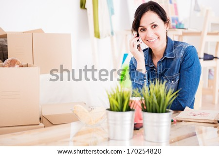 woman talking on phone during the move - stock photo
