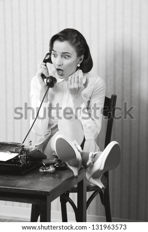 Woman talking on phone with surprised expression