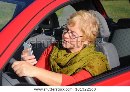 woman talking on tablet phone - stock photo