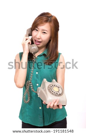 woman talking on telephone against white background