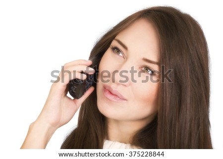 woman talking on the phone and looking away - stock photo