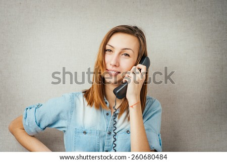 woman talking on the phone. isolated on gray background - stock photo