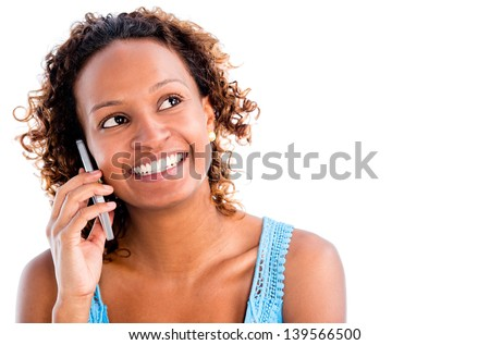 Woman talking on the phone - isolated over a white background - stock photo