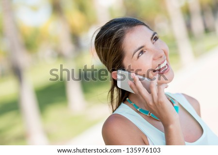 Woman talking on the phone looking very happy
