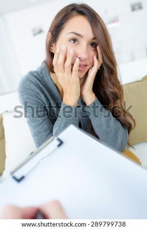 Woman talking to her psychiatrist - stock photo