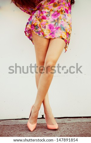 woman  tan legs in  high heel shoes and summer dress outdoor shot - stock photo