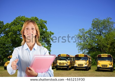 Woman teacher with school bus