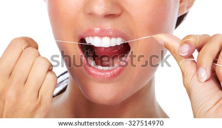 Woman teeth with dental floss. Dentistry health care. - stock photo