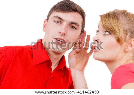 Woman telling man some secrets, couple talking gossiping. Excited emotional girl whispering to boyfriend ear