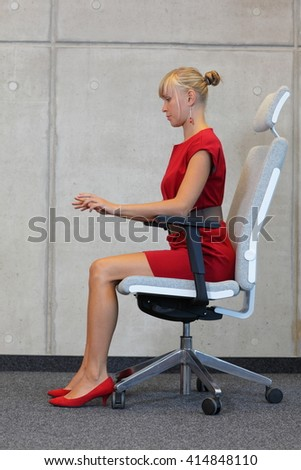 Woman testing office chair  - stock photo