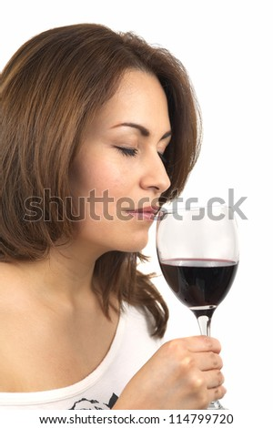 Woman testing red wine - stock photo