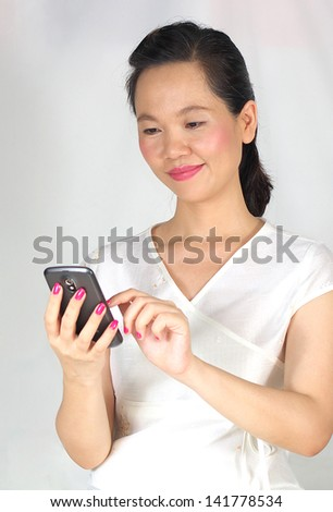 woman texting on cell phone - stock photo