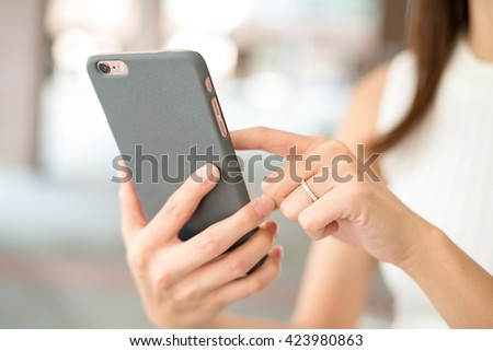 Woman texting on phone