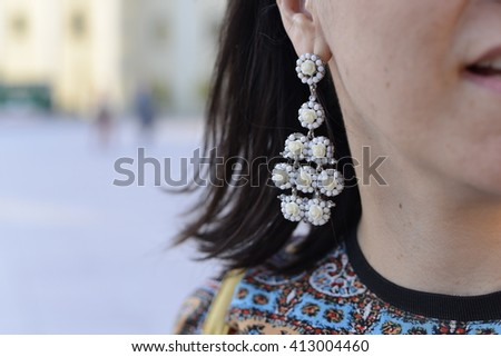 Woman that is haveing some ear jewlery. Fashion woman. - stock photo