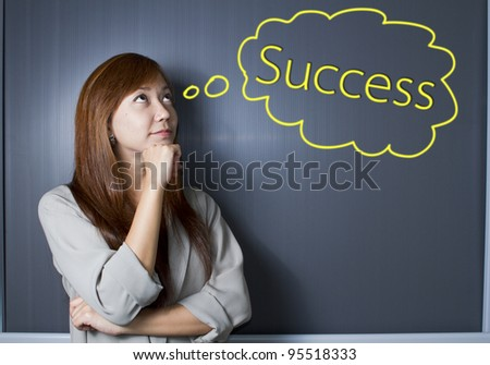woman thinking about her success.