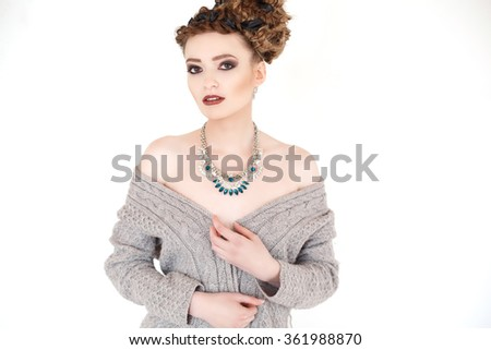 Woman thinking in looking pensive and happy in casual clothes isolated on white background. - stock photo
