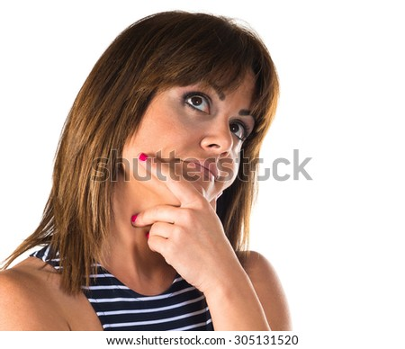 Woman thinking over white background   - stock photo