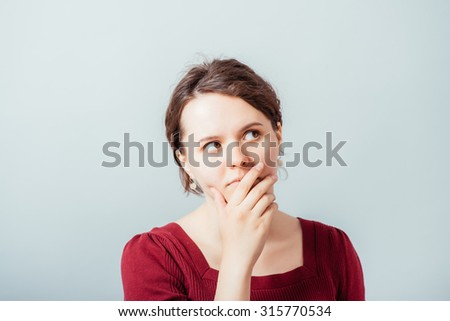 woman thinking, trying hard to remember something looking confused - stock photo