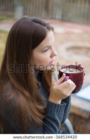 Woman Thinking with Cup