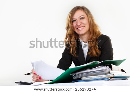 woman thinks on the calculator .
