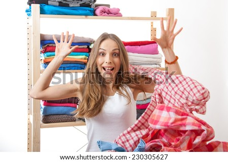 woman throws a pile of clothes, isolated on white background