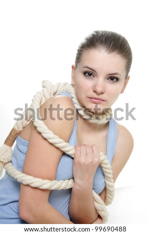 woman tied up with rope over white - stock photo
