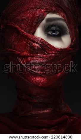 woman tied with bloody bandages - stock photo