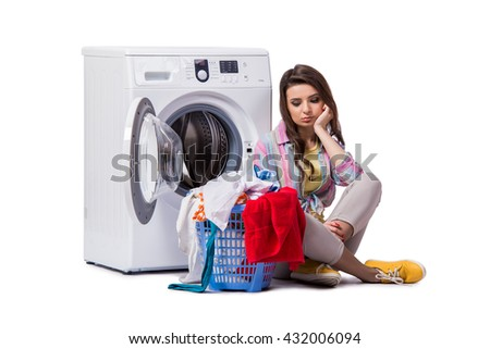 Woman tired after doing laundry isolated on white - stock photo