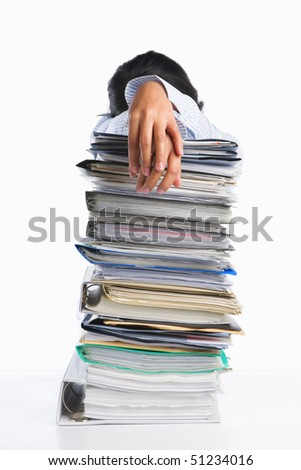 Woman tired behind pile of paper, concept for heavy workload - stock photo