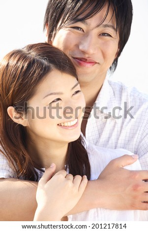 Woman to be embraced boyfriend from behind - stock photo