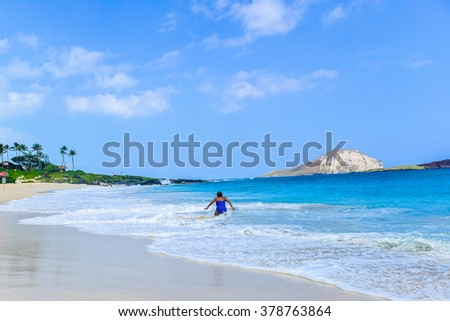 Woman to stand up to the big wave - stock photo