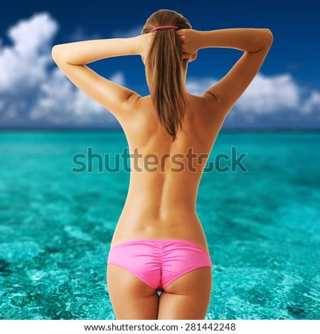 Woman topless on tropical beach with crystal clear turquoise water at Maldives. Collage.