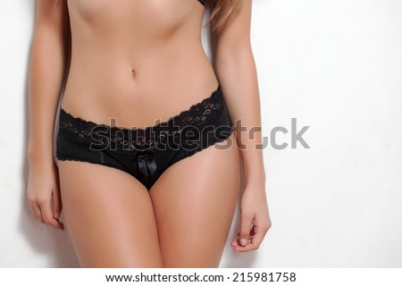 woman torso with black lingerie on white background - stock photo