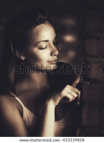 Woman touch brick wall