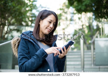 Woman touch on cellphone