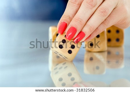 woman touching dice with her fingers 3