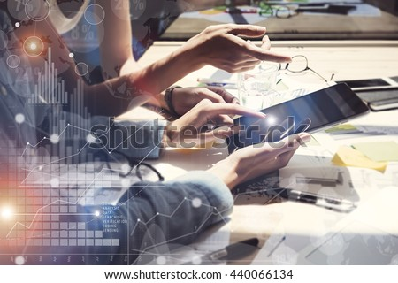 Woman Touching Screen Electronic Tablet Hand.Project Managers Researching Process.Business Team Working New Startup modern Office.International Digital Charts Interfaces.Analyze market stock.Blurred - stock photo