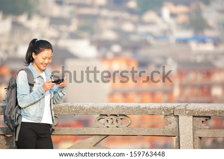 woman tourist at fenghuang ancient town,china  - stock photo