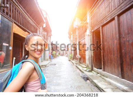woman tourist at xingping ancient town in guilin ,china - stock photo