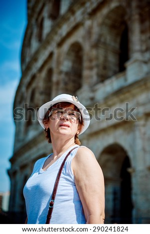 Woman tourist on the background of the Colosseum in Rome, Italy