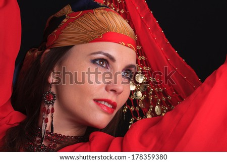 Woman traditional dancer wearing red dress isolated on white background