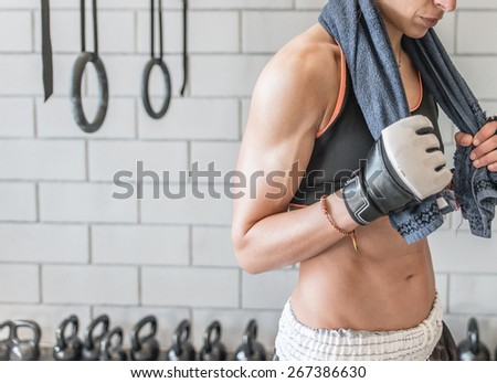woman trained body after gym and cross fit session. concept about people and sport - stock photo