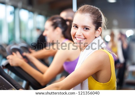 Woman training in a fitness club - stock photo