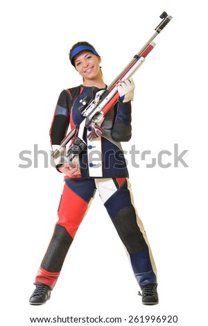 Woman training sport shooting with air rifle gun