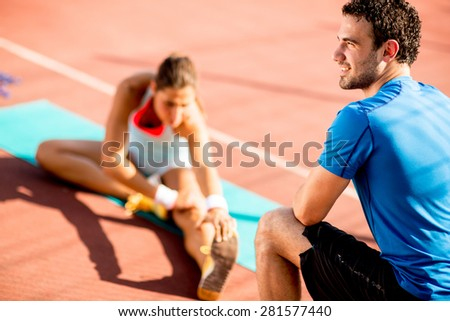 Woman training with personal trainer - stock photo