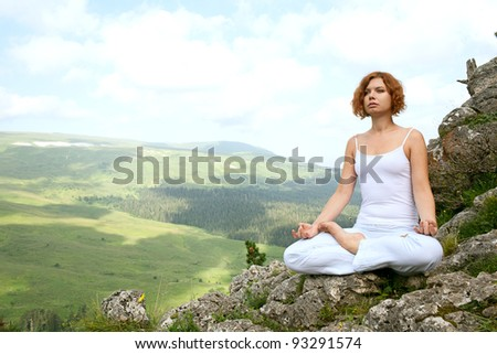 woman training yoga on beauty landscape - stock photo