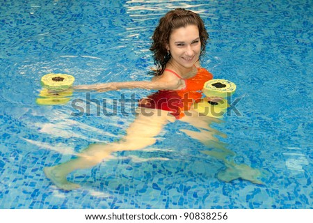 Woman trains in aqua aerobics