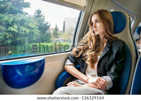 Woman travel by train - stock photo