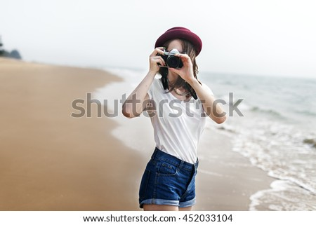 Woman Travel Photographing Beach Concept - stock photo